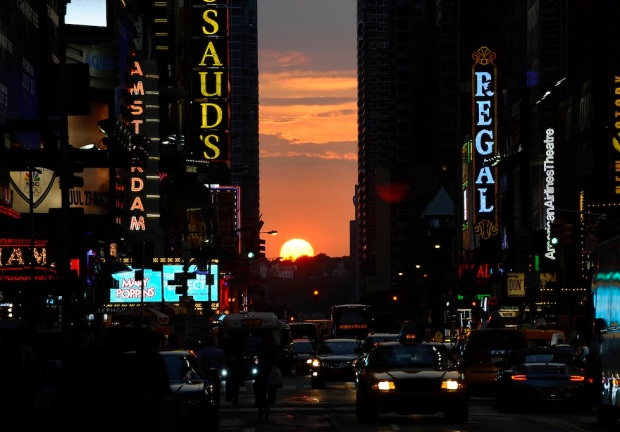The sun sets as seen from 42nd street in
